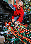 Best Christmas Lights - Bret Schultz in Harvest - 211 Crossrail Circle.   Bret Schultz with some of the 3 miles of extension cords he uses with his display. Bob Gathany / The Huntsville Times