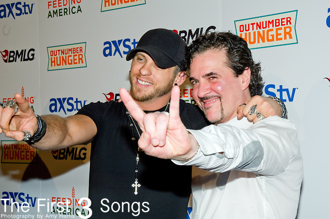 Brantley Gilbert and Scott Borchetta arrive at the ACM Experience Outnumber Hunger event at The Orleans Arena in Las Vegas, Nevada.