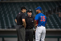 Umpires Alan Gorewitz and Austin Nelson explain the ruling on the field to AZL Cubs 2 manager Jonathan Mota (15) during an Arizona League game between the AZL Rangers and the AZL Cubs 2 at Sloan Park on July 7, 2018 in Mesa, Arizona. AZL Rangers defeated AZL Cubs 2 11-2. (Zachary Lucy/Four Seam Images)