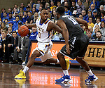 SIOUX FALLS, SD - DECEMBER 27:  Deondre Parks #0 from South Dakota State University dribbles around the defense of Quavius Copeland #11 from Middle Tennessee State in the first half of their game at the Sanford Pentagon December 27, 2015 in Sioux Falls, South Dakota. (Photo by Dave Eggen/Inertia)