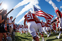 STANFORD, CA - SEPTEMBER 21: Drew Dalman #51 of the Stanford Cardinal carries the American flag as the team takes the field during a game between University of Oregon and Stanford Football at Stanford Stadium on September 21, 2019 in Stanford, California.