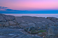 Rocky shoreline along iconic coastal fishing village of Peggy's Cove<br />Peggy's Cove<br />Nova Scotia<br />Canada