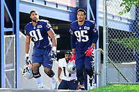 July 28, 2017: New England Patriots defensive end Deatrich Wise Jr (91) and outside linebacker Derek Rivers (95) walk to the practice fields for the New England Patriots training camp held at Gillette Stadium, in Foxborough, Massachusetts. Eric Canha/CSM