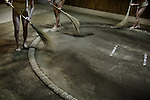 Tokyo, March 31 2013 - Cleaning of the dojo during a training at an amateur sumo club in the Asakusa area.