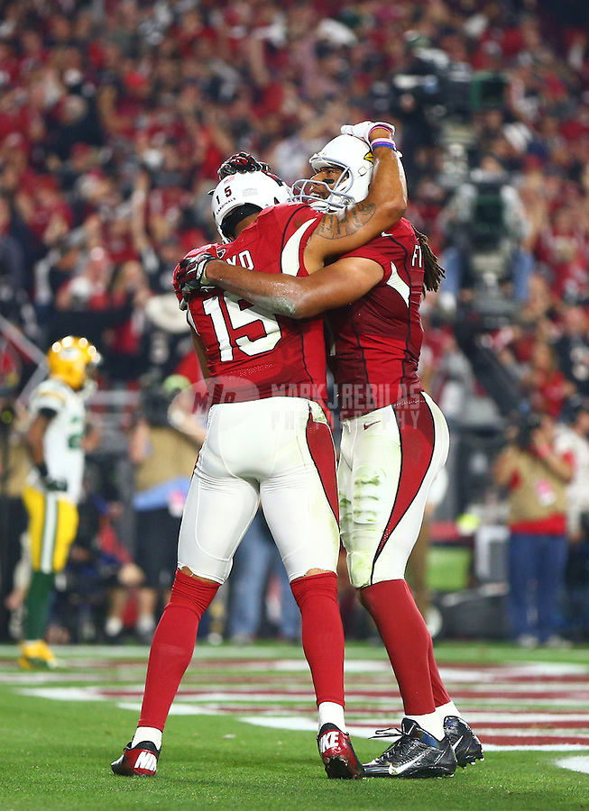Jan 16, 2016; Glendale, AZ, USA; Arizona Cardinals wide receiver Larry Fitzgerald (11) celebrates a touchdown by Michael Floyd (15) against the Green Bay Packers during an NFC Divisional round playoff game at University of Phoenix Stadium. Mandatory Credit: Mark J. Rebilas-USA TODAY Sports