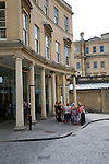 A group of women stand outside the Thermae spa complex, Bath, England
