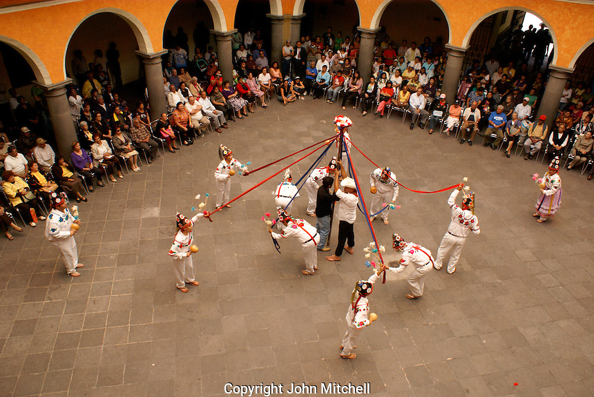 Traditional indigenous folk dancers performing in the Casa de la Cultura, city of Puebla, Mexico