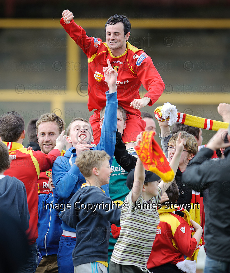 Albion Rovers' goal scorer Robert Love is celebrates with the fans at the end of the game .......