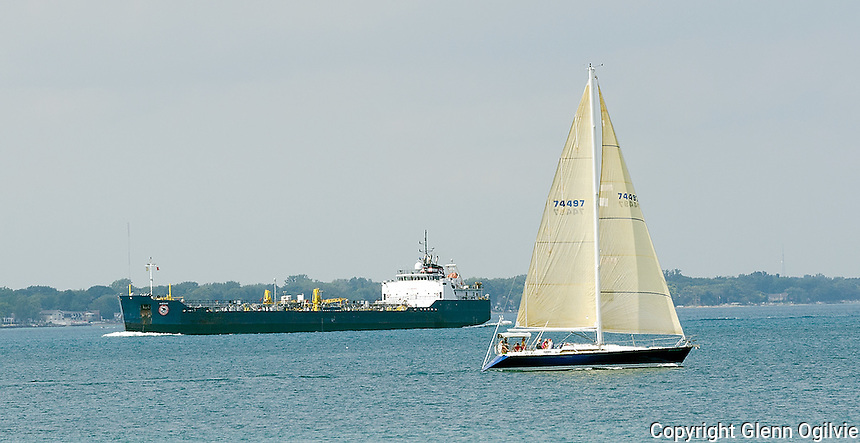 A sailboat destine for a weekend on Lake Huron passes the Algosar which is entering the St. Clair River