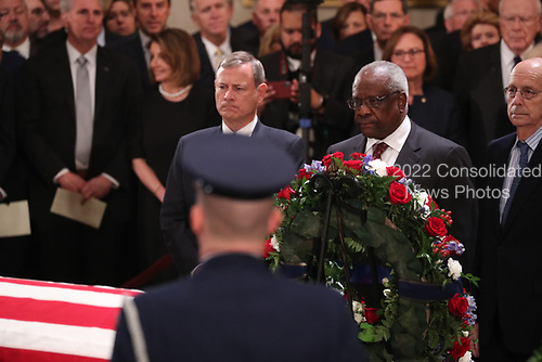 U.S. Supreme Court Chief Justice John Roberts and Associate Justice Clarence Thomas, who was nominated to the Supreme Court by former President George H.W. Bush, stand before the late president's casket together inside the U.S. Capitol Rotunda on Capitol Hill in Washington, U.S., December 3, 2018. REUTERS/Jonathan Ernst/Pool