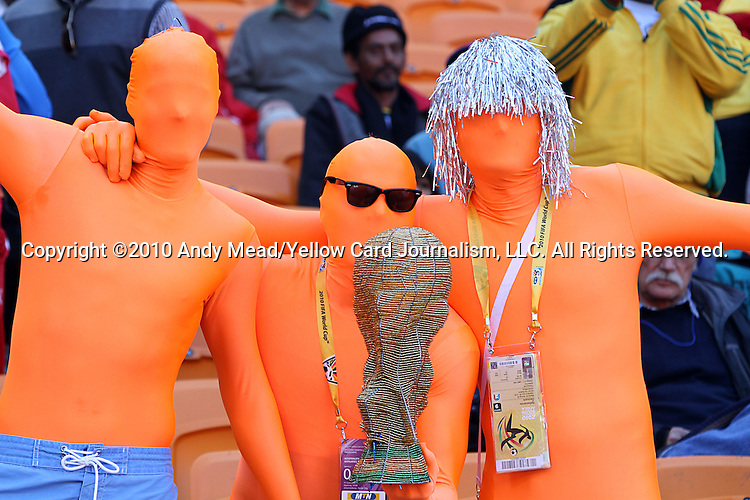 14 JUN 2010:  The Dutch version of a blue man.  Dutch fans in the stands.  The Netherlands National Team played the Denmark National Team at Soccer City Stadium in Johannesburg, South Africa in a 2010 FIFA World Cup Group E match.
