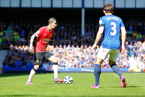 26.04.2015.  Liverpool, England. Barclays Premier League. Everton versus Manchester United. Ángel Di María of Manchester United is watched by Leighton Baines of Everton