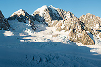 Second highest peak of Southern Alps, Mount Tasman 3497m in centre with Mt. Lendenfeld 3194m and Mount Haast 3114m on left and Torres Peak 3160m on right, Westland Tai Poutini National Park, West Coast, UNESCO World Heritage, New Zealand, NZ