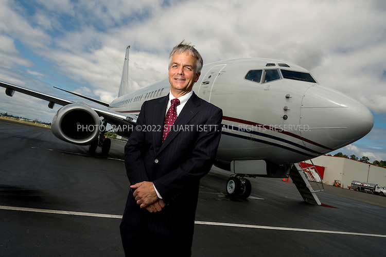 6/14/2013--Seattle, WA, USA<br /> <br /> John Wojick, senior vice president, Global Sales for Boeing Commercial Airplanes. <br /> <br /> Here Mr. Wojick poses in front of one of the company's 737 business jets at Boeing Field, (officially called the King County International Airport) as he prepares to fly on it to France for the 2013 Paris Air Show at Le Bourget.<br /> <br /> Stuart Isett for The Wall Street Journal<br /> Slug: WOJICK