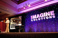 National Geographic Traveler Magazine's Editor in Chief and  Vice President, Keith Bellows, takes center stage at the second annual Imagine Solutions Conference, held at the Ritz Carlton Golf Resort, Naples, Florida, USA, March 21, 2011.. Photo by Debi Pittman Wilkey.