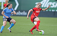 Portland, Oregon - Saturday July 2, 2016: Portland Thorns FC midfielder Amandine Henry (28) controls the ball in front of Sky Blue FC forward Catherine Zimmerman (29) during a regular season National Women's Soccer League (NWSL) match at Providence Park.