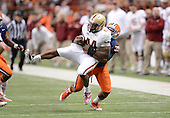Syracuse Orange linebacker Cameron Lynch (38) tackles Boston College Eagles running back Andre Williams (44) during a game at the Carrier Dome on November 30, 2013 in Syracuse, New York.  Syracuse defeated Boston College 34-31.  (Copyright Mike Janes Photography)