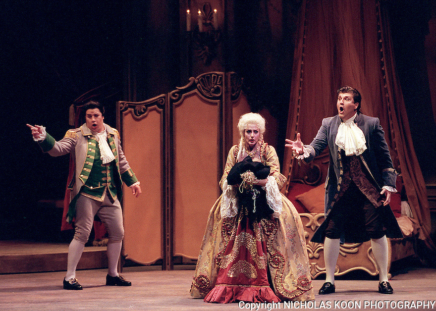 2000 - MANON LESCAUT - Brother, Lescaut (Frank Hernandez) and lover, des Grieux (Hugh Smith), far right. urge Manon (Sylvie Valayre) to leave the jewels and escape from the guards who will arrest her in Opera Pacific's performance of Manon Lescaut.