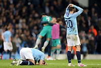 Manchester City's Ilkay Gundogan (left) and Bernardo Silva are dejected at the final whistle<br /> <br /> Photographer Rich Linley/CameraSport<br /> <br /> UEFA Champions League - Quarter-finals 2nd Leg - Manchester City v Tottenham Hotspur - Wednesday April 17th 2019 - The Etihad - Manchester<br />  <br /> World Copyright © 2018 CameraSport. All rights reserved. 43 Linden Ave. Countesthorpe. Leicester. England. LE8 5PG - Tel: +44 (0) 116 277 4147 - admin@camerasport.com - www.camerasport.com