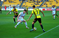Wellington's Nathan Burns tries to beat Adelaide's Ryan Strain during the A-League football match between Wellington Phoenix and Adelaide United at Westpac Stadium in Wellington, New Zealand on Saturday, 27 January 2018. Photo: Dave Lintott / lintottphoto.co.nz