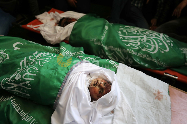 Mourners gather around the bodies of Palestinians, who were killed in Israeli strikes during their funeral at a mosque in Beit Lahia in the northern Gaza Strip on May 6, 2019. The Israeli attack on the Gaza Strip left 25 Palestinians dead and at least 154 injured, after Israel and Hamas reached a ceasefire agreement on early morning hours, mediated by Egypt. Photo by Ashraf Amra
