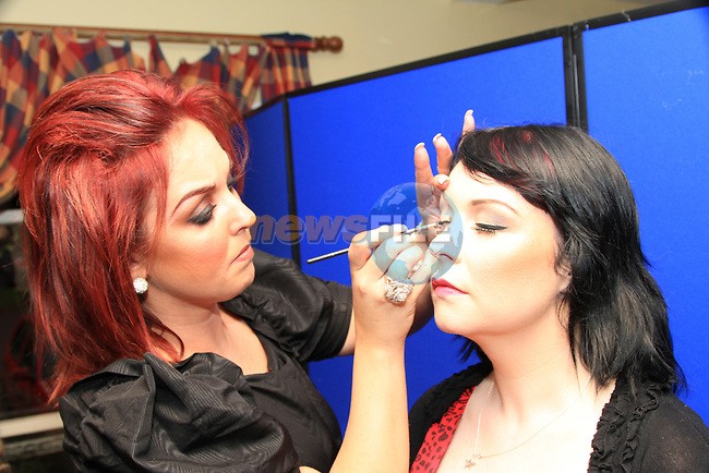 Emma Woods applying make up to Siobhan Boyce  before participating in the fashion show..Picture: Shane Maguire / www.newsfile.ie