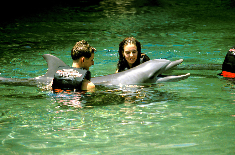 Hawaii: Waikoloa, Swimming with dolphins, model released. Photo: hikids105.Photo copyright Lee Foster, www.fostertravel.com, 510/549-2202, lee@fostertravel.com