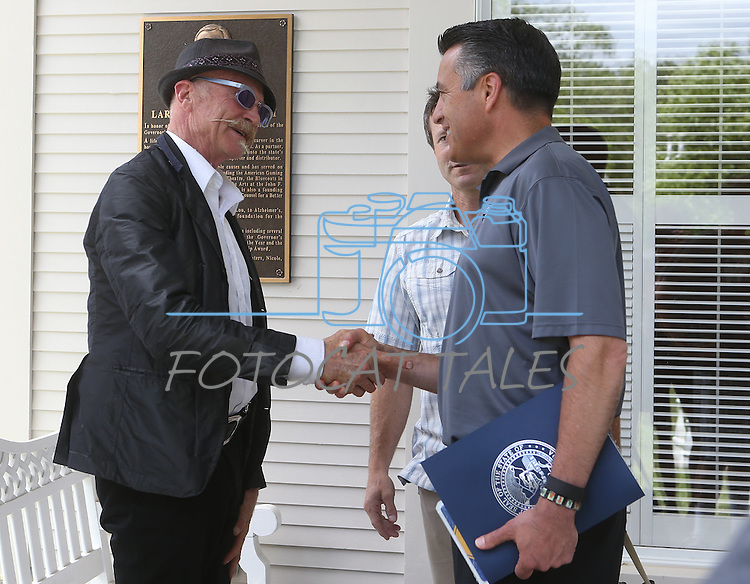 Gov. Brian Sandoval meets cultural icon Gary Fisher at the kick off ceremony for Epic Rides Carson City Off-Road at the Governor's Mansion in Carson City, Nev., on Friday, June 17, 2016. Epic Rides founder Todd Sadow is at rear. <br />Photo by Cathleen Allison