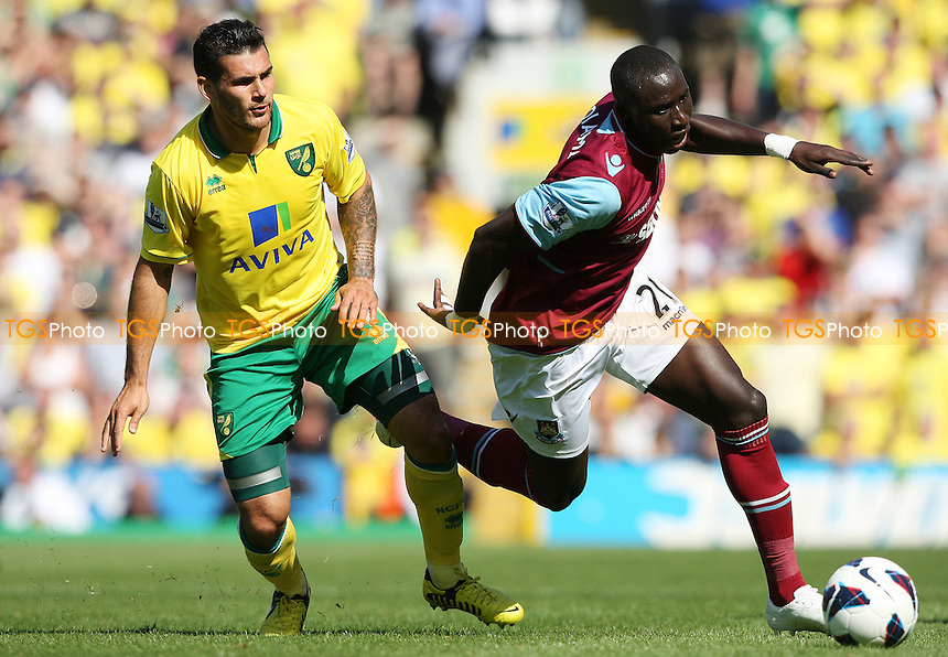 Mo Diame of West Ham and Bradley Johnson of Norwich - Norwich City vs West Ham United, Barclays Premier League at Carrow Road, Norwich - 15/09/12 - MANDATORY CREDIT: Rob Newell/TGSPHOTO - Self billing applies where appropriate - 0845 094 6026 - contact@tgsphoto.co.uk - NO UNPAID USE.