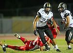 Lawndale, CA 09/26/14 - Rory Hubbard (Peninsula #22), Anthony Gray (Lawndale #8) and Christian Coleman (Lawndale #10) in action during the Palos Verdes Peninsula vs Lawndale CIF Varsity football game at Lawndale High School.  Lawndale defeated Peninsula 42-21