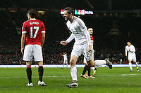 Gylfi Sigurosson of Swansea City celebrates scoring his goal to make it 1-1 during the Barclays Premier League match between Manchester United and Swansea City played at Old Trafford, Manchester on January 2nd 2016