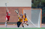 Los Angeles, CA 02/28/14 - Tierney Larson (Marist #12), Liz Shaeffer (USC #11) and Alexa Wilson (USC #13) in action during the Marist Red Foxes vs University of Southern California Trojans NCAA Women's lacrosse game at Loker Track Stadium on the USC Campus.  Marist defeated USC 12-10.