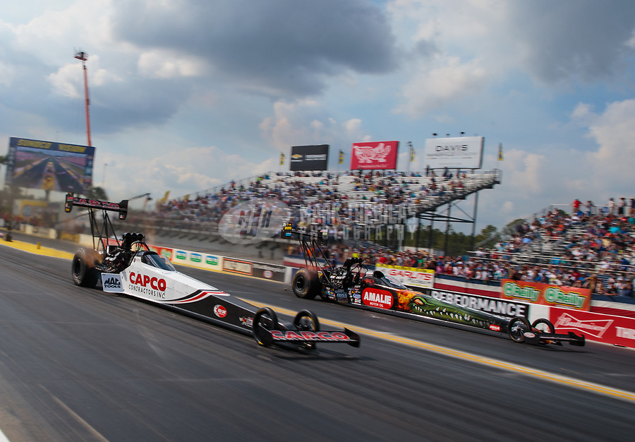 Mar 15, 2019; Gainesville, FL, USA; NHRA top fuel driver Steve Torrence (near) races alongside Terry McMillen during qualifying for the Gatornationals at Gainesville Raceway. Mandatory Credit: Mark J. Rebilas-USA TODAY Sports