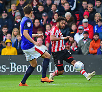 Lincoln City's Bruno Andrade crosses under pressure from Crewe Alexandra's Perry Ng<br /> <br /> Photographer Andrew Vaughan/CameraSport<br /> <br /> The EFL Sky Bet League Two - Lincoln City v Crewe Alexandra - Saturday 6th October 2018 - Sincil Bank - Lincoln<br /> <br /> World Copyright &copy; 2018 CameraSport. All rights reserved. 43 Linden Ave. Countesthorpe. Leicester. England. LE8 5PG - Tel: +44 (0) 116 277 4147 - admin@camerasport.com - www.camerasport.com