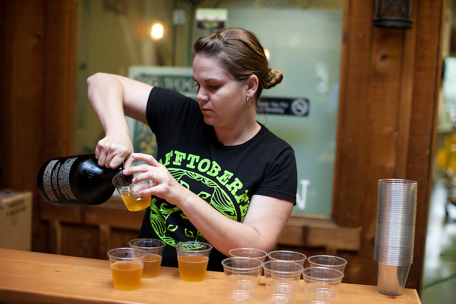 """An Big Woods Brewing Company employee pours samples of Six Foot Blonde, a Blonde Ale, during """"beer school,"""" a tour of the brewery in Nashville, Ind. on Saturday, Sept. 6, 2014. (Photo by James Brosher)"""