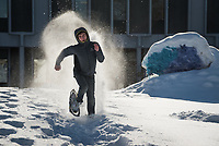 Cory Stuart tries for best time in a snowshoe race across UAA's Cuddy Quad during Winterfest festivities.