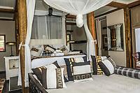 Africa, Botswana, Khwai, The Lodge, Feline Fields, edge of the Kalahari desert. Bedroom at The Lodge.