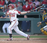 NWA Democrat-Gazette/ANDY SHUPE<br />Arkansas second baseman Carson Shaddy follows through with his swing as he hits a solo home run against Kent State Friday, March 9, 2018, during the fifth inning at Baum Stadium in Fayetteville. Visit nwadg.com/photos to see more photographs from the game.