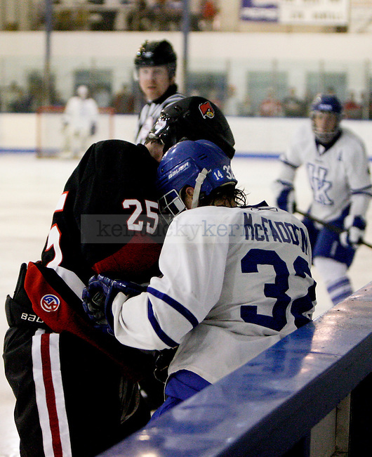 Hunter McFadden gets hit into the bench during the UK club hockey game against Louisville on September 27, 2013 at the Lexington Ice Center in Lexington, Ky. Photo by Jonathan Krueger
