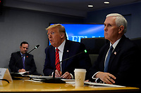 United States President Donald J. Trump, second from right, speaks during a teleconference with governors at the Federal Emergency Management Agency headquarters, Thursday, March 19, 2020, in Washington, DC US Vice President Mike Pence listens at right. <br /> Credit: Evan Vucci / Pool via CNP/AdMedia