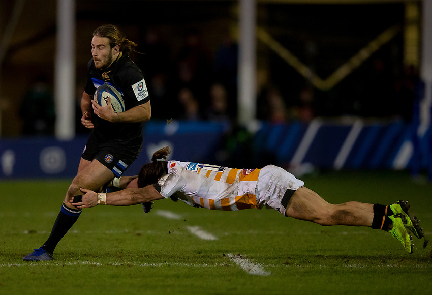 Bath Rugby's Max Clark evades the tackle of Wasps' Michele Campagnaro<br /> <br /> Photographer Bob Bradford/CameraSport<br /> <br /> European Rugby Heineken Champions Cup Pool 1 - Bath Rugby v Wasps - Saturday 12th January 2019 - The Recreation Ground - Bath<br /> <br /> World Copyright © 2019 CameraSport. All rights reserved. 43 Linden Ave. Countesthorpe. Leicester. England. LE8 5PG - Tel: +44 (0) 116 277 4147 - admin@camerasport.com - www.camerasport.com
