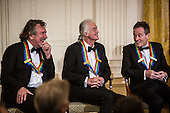 Robert Plant, Jimmy Page, and John Paul Jones (L-R) of the band Led Zeppelin attend the Kennedy Center Honors reception at the White House on December 2, 2012 in Washington, DC. The Kennedy Center Honors recognized seven individuals - Buddy Guy, Dustin Hoffman, David Letterman, Natalia Makarova, John Paul Jones, Jimmy Page, and Robert Plant - for their lifetime contributions to American culture through the performing arts. .Credit: Brendan Hoffman / Pool via CNP