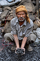 man with coal, Amritasr, India, 2011