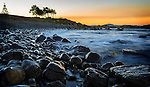 The rocky shore at sunset in the seaside town of Forster on the mid north coast of New South Wales in Australia