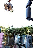 Roma, 27 Luglio 2009.Sgombero comunità rom che viveva in case di muratura sotto l'Autostrada Roma-L'Aquila.Demolizione delle case con ruspe.Eviction of Roma who live in brick houses.Demolition of houses with bulldozers