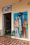 Cojimar, Cuba; a mural of Ernest Hemingway painted on a wall at the entrance to a market in Cojimar, the fishing village that inspired the Old Man and the Sea novel