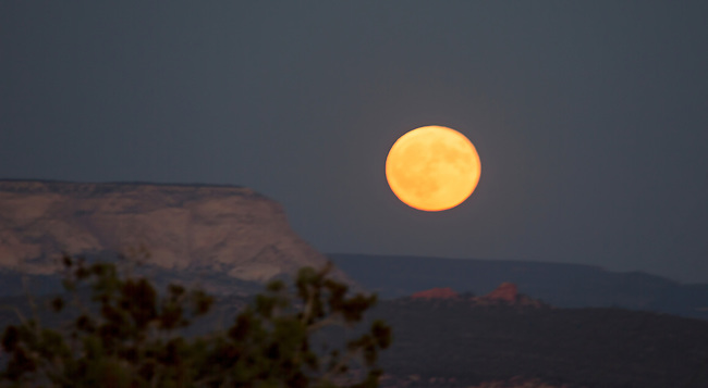 A full moon rises over the outhern Utah landscape near Kanab.