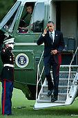 United States President Barack Obama salutes the Marine Guard as he stops off of Marine One on the South Lawn of the White House September 13, 2012 in Washington, DC. Obama returned to Washington after a two-day campaign trip to Nevada and Colorado..Credit: Chip Somodevilla / Pool via CNP
