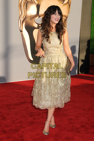 Zooey Deschanel.BAFTA Brits to Watch Event held at the Belasco Theatre, Los Angeles, California, USA, 9th July 2011..full length dress hand clutch bag  sleeveless prom shiny  ankle strap gold shoes feet beaded .CAP/ADM/BP.©Byron Purvis/AdMedia/Capital Pictures.
