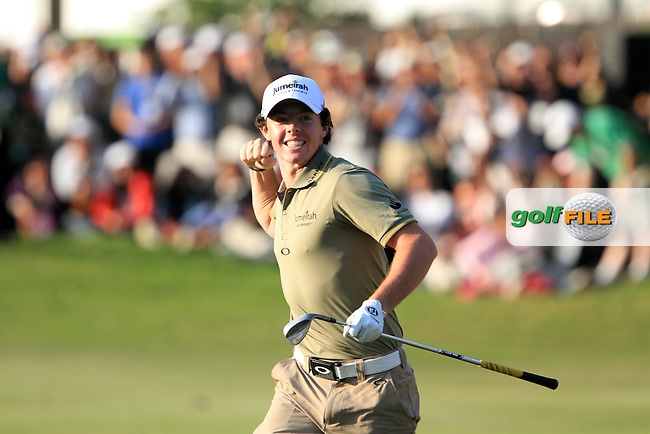 Rory McIlroy (NIR) chips out of a bunker into the hole on the 18th green to win the 2011 UBS Hong Kong Open...